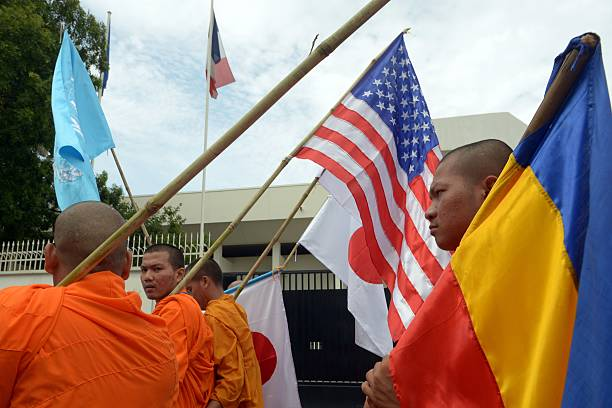 Cambodian Buddhist Monks Hold International Flags As They March To