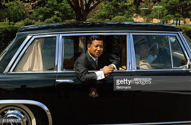 Cambodian Chief of State Prince Norodom Sihanouk leans out limousine window as he leaves Khemarin Palace, November 7th, after Mrs. John F. Kennedy...