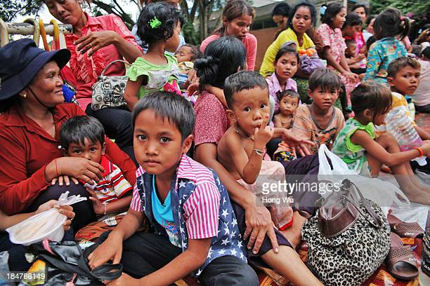 Cambodian children and their families queue up for the next day's medical care outside a children's hospital on September 25 2013 in Siem Reap...