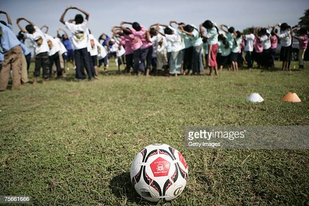 Cambodian children from the 'Spirit of Soccer' project warm up for a soccer training session at the Roka Poenung Primary School as Laureus World...