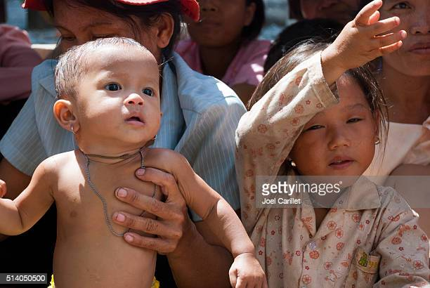 Cambodian children waiting for vaccination