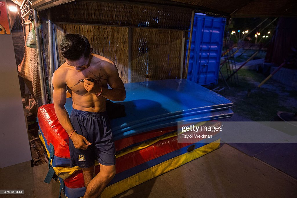 A Cambodian circus artist prepares for a show on July 1, 2015 at Phare - The Cambodian Circus in Siem Reap, Cambodia. Phare Ponleu Salpak is an organization providing free education and artistic training to Cambodian children. Students in the organization's circus program often go on to careers performing both internationally and domestically at venues like Phare - The Cambodian Circus in Siem Reap.