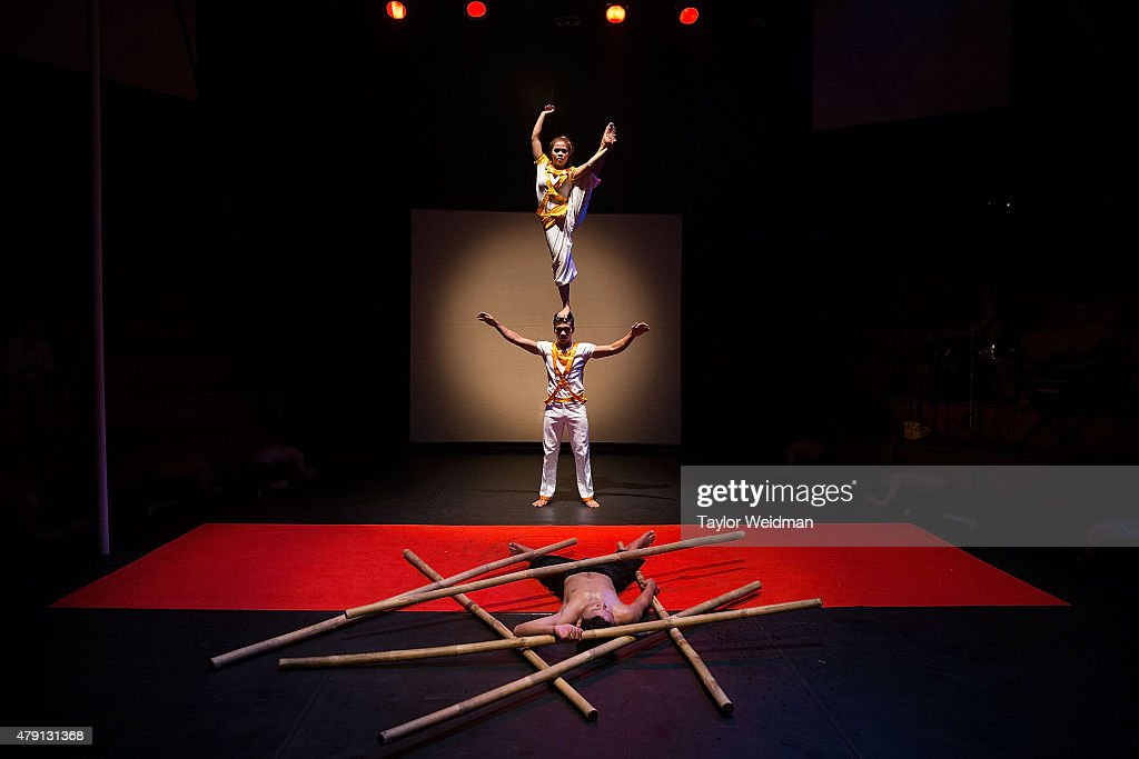 Cambodian circus artists perform in front of a crowd of foreign tourists on July 1, 2015 during a performance of 'Eclipse' at Phare - The Cambodian Circus in Siem Reap, Cambodia. Phare Ponleu Salpak is an organization providing free education and artistic training to Cambodian children. Students in the organization's circus program often go on to careers performing both internationally and domestically at venues like Phare - The Cambodian Circus in Siem Reap.