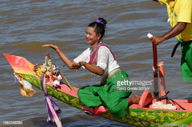 A Cambodian dancer in traditional costume performs on a dragon boat during the Water Festival in Phnom Penh on November 22 2018