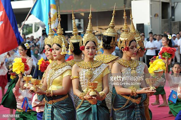 Cambodian dancers perform during a Cambodian People's Party ceremony marking the 37th anniversary of the fall of the Khmer Rouge regime in Phnom Penh...