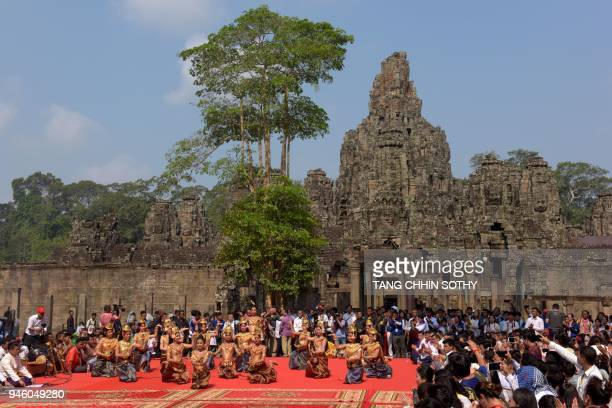 Cambodian dancers perform during Khmer New Year celebrations at Bayon temple in the Angkor complex in Siem Reap province on April 14 2018