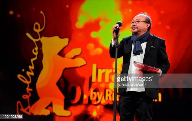 Cambodian documentary film director and screenwriter Rithy Panh delivers a speech after receiving the Berlinale Documentary Award during the awarding...