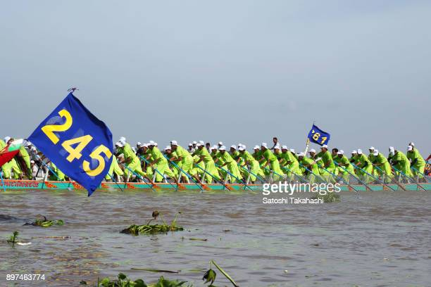 Cambodian dragon boat crew members row their boat on the Tonle Sap river during the second day of the threeday Water Festival boat race The country's...