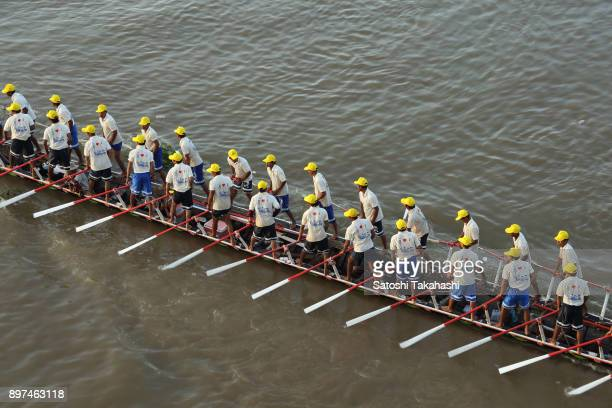 Cambodian dragon boat crew members train on the Tonle Sap river after the first day of the threeday Water Festival boat race The country's annual...