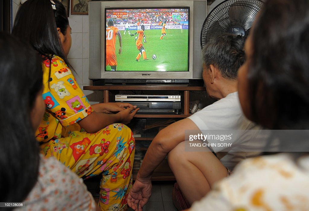 A Cambodian family watches television of World Cup football match at their home in Phnom Penh on June 15, 2010.