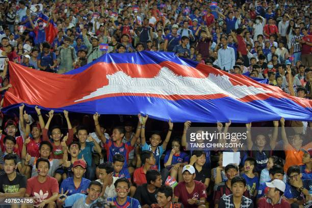 Cambodian fans hold a national flag during group E football match in round 2 of the 2018 FIFA World Cup qualification preliminaries at the National...