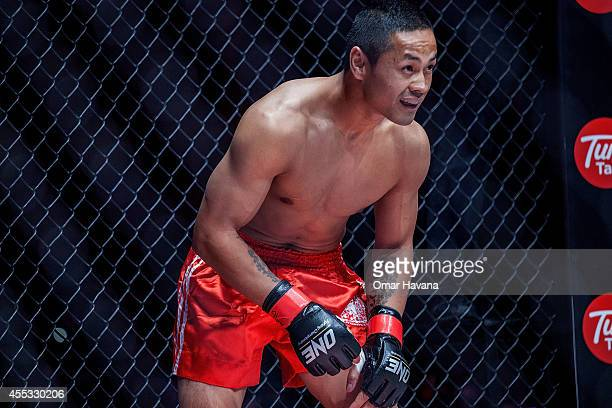 Cambodian fighter Suasday Chau warms up inside the cage before his fights against Arnaud Lepont during One FC Cambodia on September 12 2014 in Phnom...