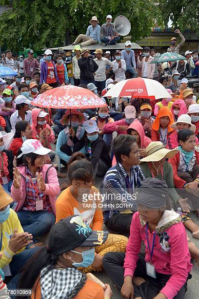 Cambodian garment factory workers sit down to block a street during a protest in front of the Ministry of Social Affairs, Veterans, and Youth...