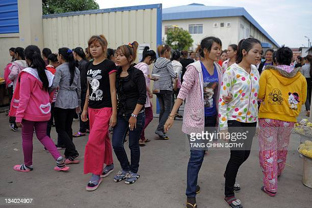 Cambodian garment wokers walk out from a factory in Phnom Penh on November 24, 2011. Cambodia has boosted healthcare for garment and footwear workers...