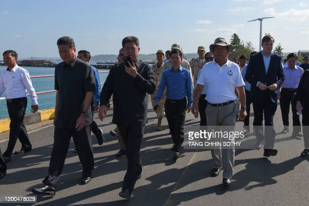 Cambodian government officials walk to the dock as the Westerdam cruise ship approaches the port in Sihanoukville on February 13 where the liner has...
