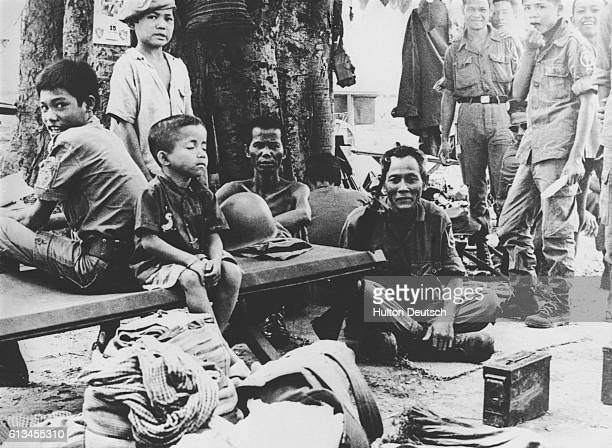 Cambodian government soldiers wait to go into battle shortly before the fall of Phnom Penh.
