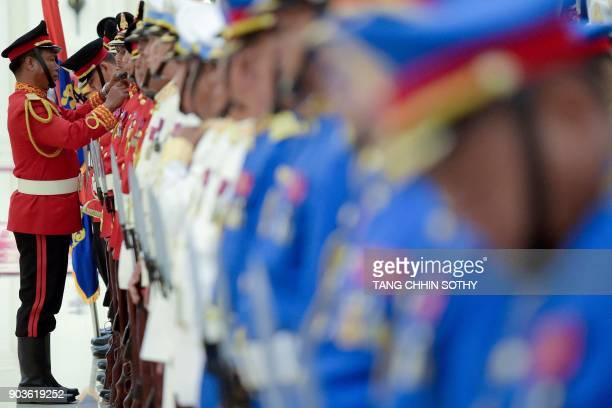 Cambodian guard of honour prepare to welcome Chinese Premier Li Keqiang at the Peace Palace in Phnom Penh on January 11 2018 Li Keqiang is on a...