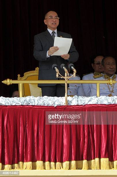 Cambodian King Norodom Sihamoni addresses people during the 10th anniversary of his coronation in front of the Royal Palace in Phnom Penh on October...