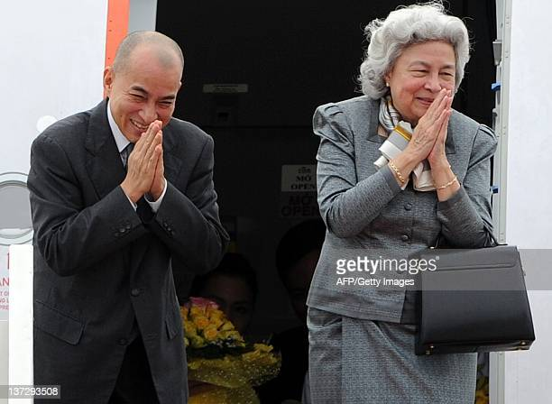Cambodian King Norodom Sihamoni and his mother former Queen Norodom Monineath Sihanouk bid farewell to government officials as they board a plane...