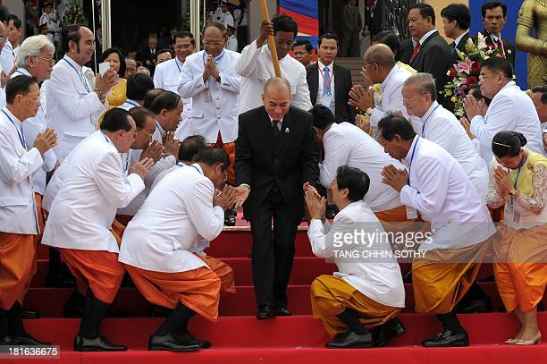 Cambodian King Norodom Sihamoni greets new parliamentarians during the first parliament meeting at the National Assembly building in Phnom Penh on...