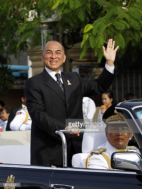 Cambodian King Norodom Sihamoni greets wellwishers as he parades the streets of Phnom Penh on November 9 2013 Cambodia celebrated the 60th...