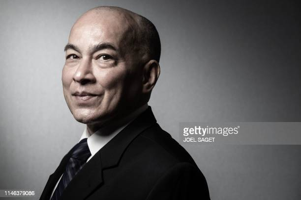 Cambodian King Norodom Sihamoni poses during a photo session in his workshop at the Institut de France in Paris on May 24 2019