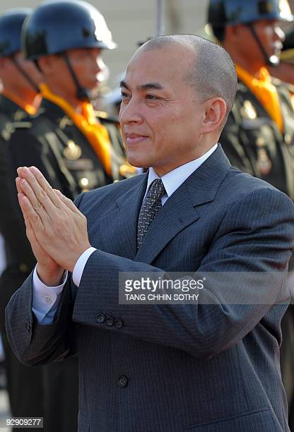 Cambodian King Norodom Sihamoni walks past honor guard during an Independence Day celebration at the Independent Monument in Phnom Penh on November 9...