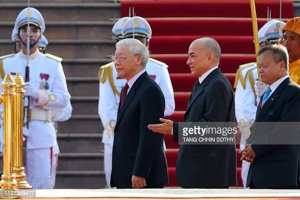 Cambodian King Norodom Sihamoni welcomes Vietnamese President Nguyen Phu Trong during arrival ceremony at the Royal Palace in Phnom Penh on February...
