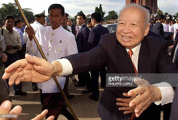 Cambodian King Norodom Sihanouk reaches out to the crowd during the Independence Day ceremony in Phnom Penh, 09 November 2001. Sihanouk has abdicated...