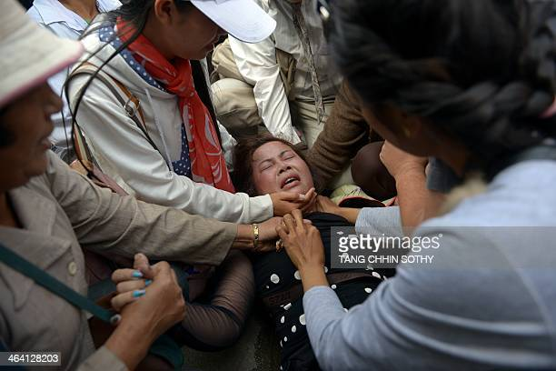 A Cambodian land rights activist faints during a protest in Phnom Penh on January 21 2014 Cambodian police detained 11 activists on January 21 as...