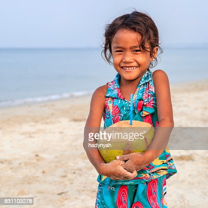 Cambodian Little Girl Sitting On A Boat Tonle Sap Cambodia