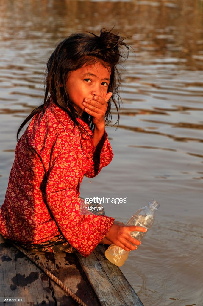 Little Girl In The Boat Cambodia High-Res Stock Photo
