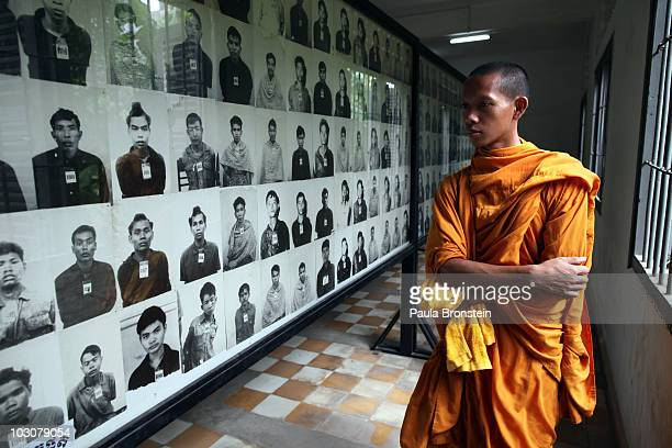 Cambodian looks at photos of victims on display at the Toul Sleng Genocide museum July 25, 2010 in Phnom Penh province, Cambodia. The UN -backed...