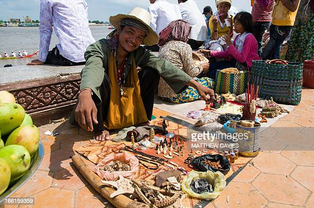 Cambodian man sells lucky charms And Buddhist Relics And Parafinalia in The Cambidian Capital Phnom Penh during the water festival Cambodia