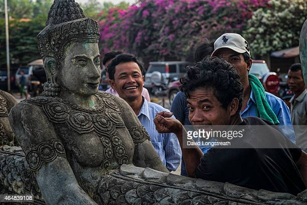 Cambodian men look on from a temple complex Monday Feb 16 2015 A stable Cambodia has meant that each year since records were kept in 1993 the number...