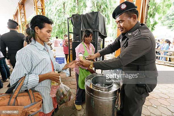 Cambodian migrant workers are fed by the Thai military before they cross the border and return to their homes in Cambodia during a mass exodus...