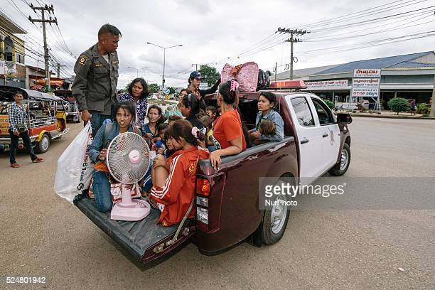 Cambodian migrants are transferred to a holding area before crossign the border from Thailand to Cambodia during a mass exodus Aranyaprathet Railway...