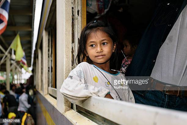 Cambodian migrants arrive by train at Aranyapathet Railway Station in Thailand before crossing the border to return home during a mass exodus of...