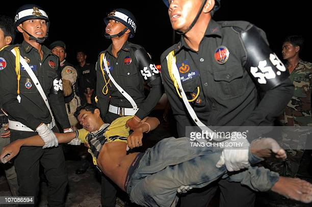 Cambodian military police carry a body from a bridge in Phnom Penh on November 23 2010 after at least 278 people died in a stampede on a bridge in...