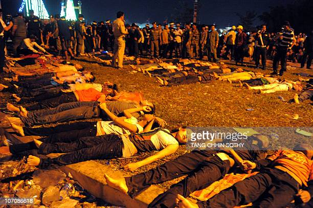 Cambodian military police surround bodies near a bridge in Phnom Penh on November 23 2010 after at least 313 people died in a stampede on a bridge in...