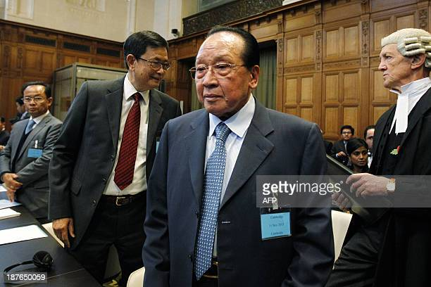 Cambodian Minister of Foreign Affairs Hor Namhong arrives for a trial between Cambodia and Thailand about the Temple of Preah Vihear in the hall of...