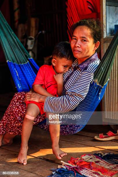 cambodian mother with her son lie on the hammock, cambodia - cambodian culture stock photos and pictures