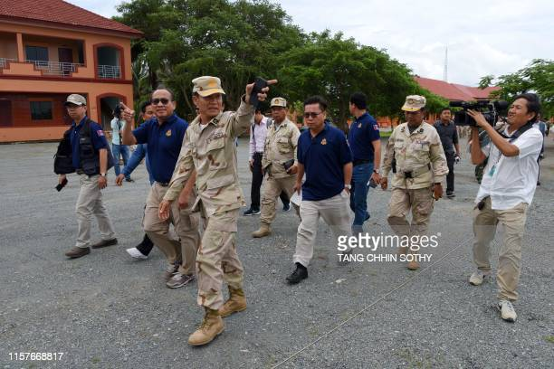 Cambodian Naval General Ouk Seyha guides journalists on a government organised media tour to the Ream naval base in Preah Sihanouk province on July...