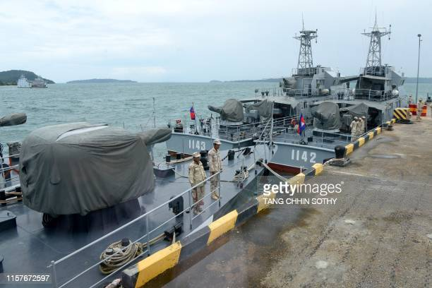 Cambodian naval personnel are seen on boats berthed at a jetty at the Ream naval base in Preah Sihanouk province on July 26, 2019 during a government...