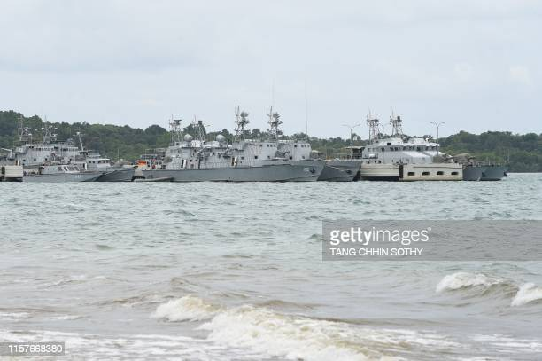 Cambodian navy boats are berthed at a jetty in Ream naval base in Preah Sihanouk province during a government organized media tour on July 26, 2019....