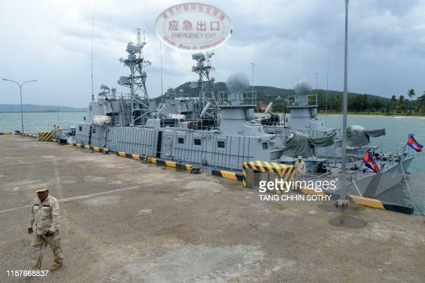 Cambodian navy personnel is seen walking along a jetty during a government organised media tour to the Ream naval base in Preah Sihanouk province on...