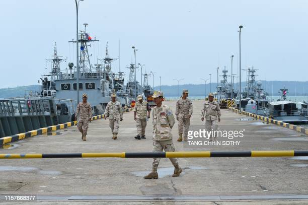 Cambodian navy personnel walk on a jetty in Ream naval base in Preah Sihanouk province during a government organized media tour on July 26 2019...