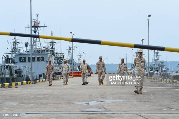Cambodian navy personnel walk on a jetty in Ream naval base in Preah Sihanouk province during a government organized media tour on July 26, 2019. -...