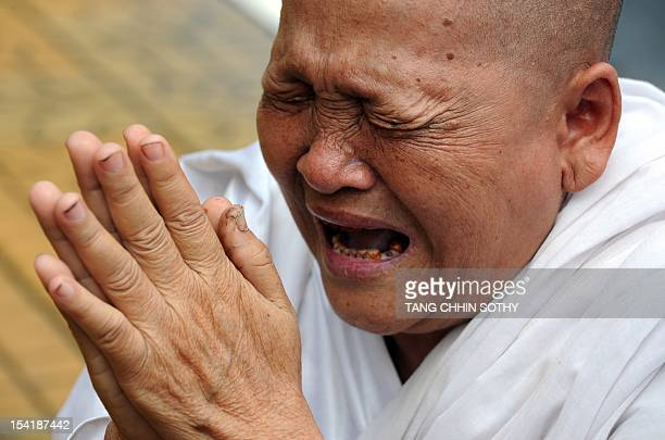 A Cambodian nun cries as she mourns of the death of the late former king Norodom Sihanouk in front of the Royal Palace in Phnom Penh on October 16...