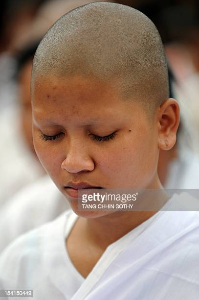 A Cambodian nun prays in front of the Royal Palace in Phnom Penh on October 15 2012 to remember the country's former king Norodom Sihanouk Chanting...